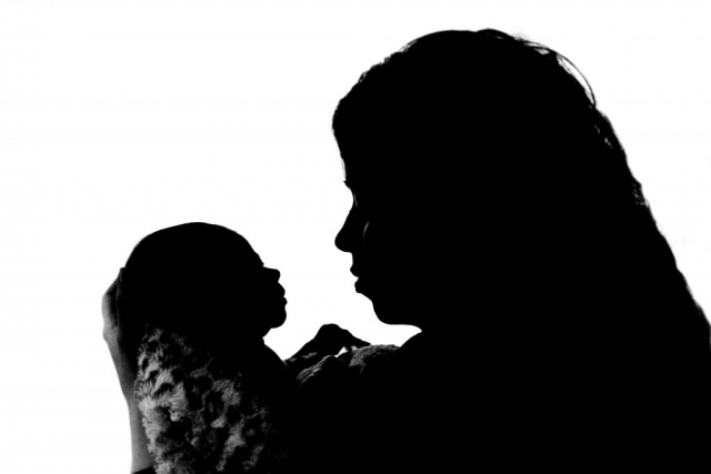Sillouette of baby and mother